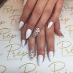 White pointy gel nails with swarovski detailing